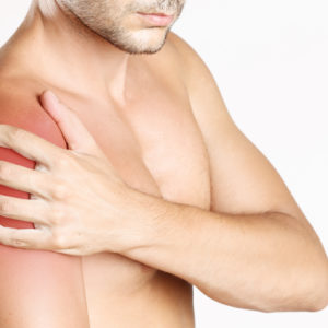 Studio shot of young man with shoulder pain